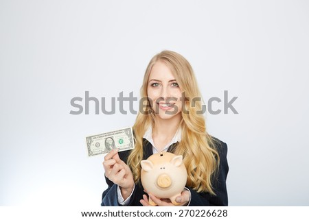 Businesswoman Holding Piggy Bank with an one dollar bill.