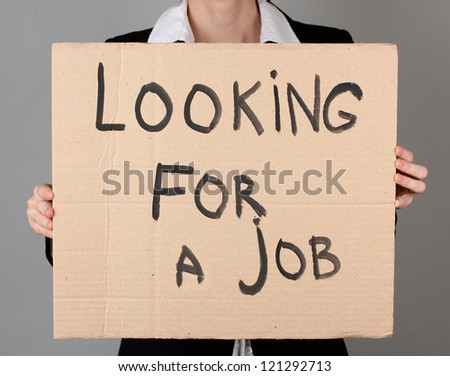 Businesswoman holding sign I