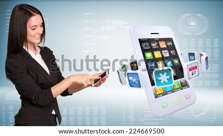 Businesswoman holding smart phone and smiling. Big smart phone with app icons. High-tech graphs at backdrop - stock photo