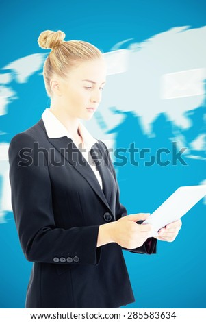 Businesswoman holding tablet against world map with envelopes - stock photo