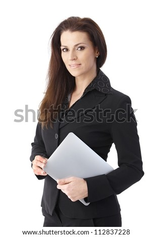 Businesswoman holding tablet pc smiling at camera. - stock photo