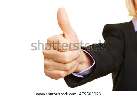 Businesswoman holding thumb up as sign of approval