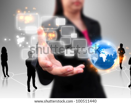 businesswoman holding touchscreen