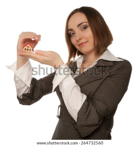 Businesswoman holding toy house in her hand isolated on white - stock photo