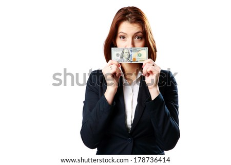 Businesswoman holding US dollars isolated on a white background - stock photo