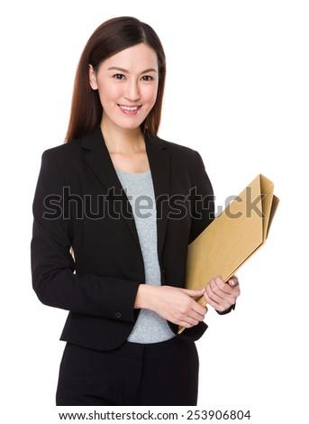 Businesswoman holds folder - stock photo