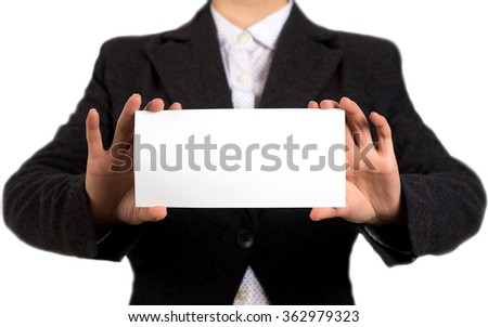 Businesswoman in a black jacket and white shirt holding blank card in his hand. Girl on a white background. Selective focus.