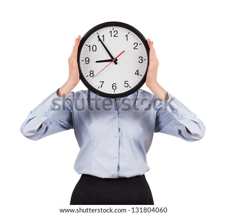 Businesswoman in a gray shirt holds a round clock