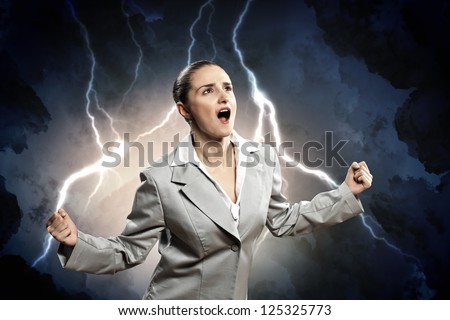 businesswoman in anger screaming against lightning background