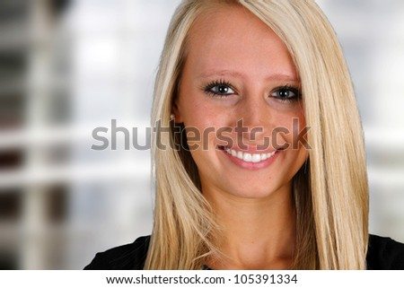 Businesswoman in black standing outside her office - stock photo