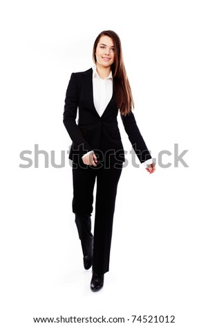 Businesswoman in black suit walking in full length on white background. - stock photo