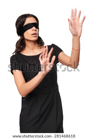 Businesswoman in blindfold walking with hands forward isolated on white background - stock photo