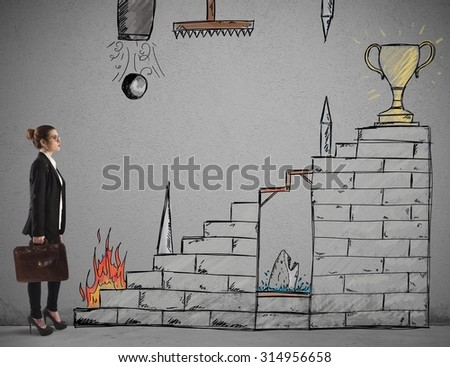 Businesswoman in front of staircase with obstacles - stock photo