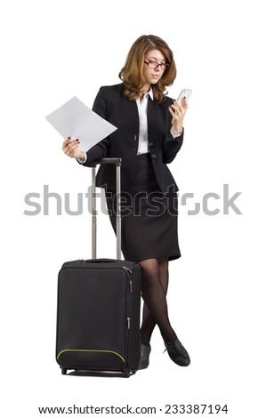 Businesswoman in full length  with suitcase, over white background - stock photo