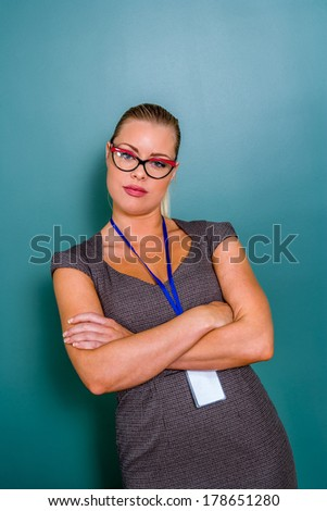 businesswoman in glasses and badge - stock photo