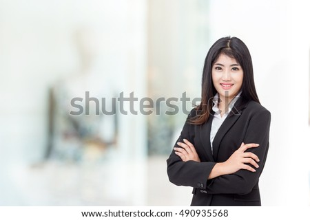 businesswoman in her office background