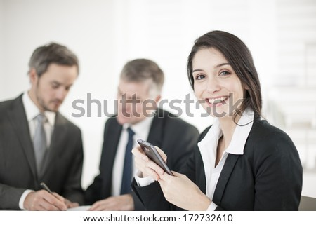 Businesswoman in meeting - stock photo