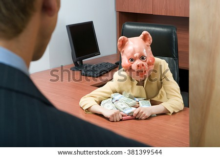 Businesswoman in pig mask holding money - stock photo