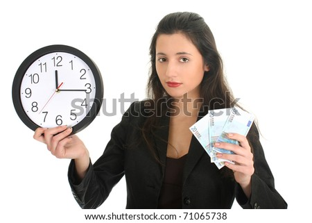 Businesswoman in suit holding a clock and money over white