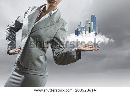 Businesswoman in suit holding tablet pc on palm