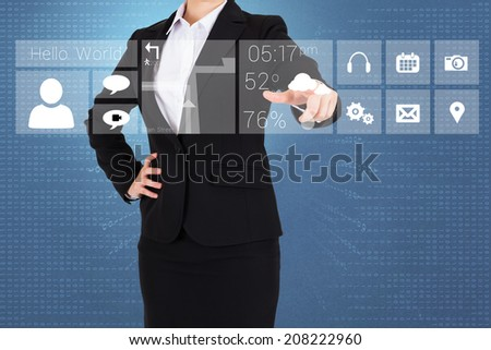 Businesswoman in suit pointing finger to app menu against blue background