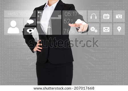 Businesswoman in suit pointing finger to app menu on grey background
