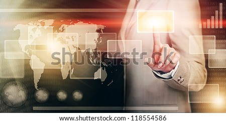 businesswoman in virtual interface pressing a button with her finger - future business solutions