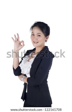 businesswoman indicating OK sign isolated on white background - stock photo