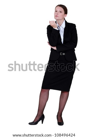 Businesswoman inspecting her nails