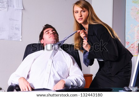 businesswoman is seducing her boss at office - stock photo