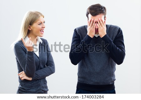 Businesswoman is shouting at her colleague,Did you hear me?! - stock photo