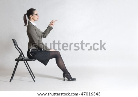 businesswoman is sitting on the chair