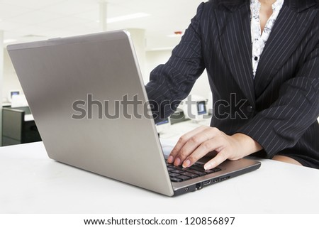 Businesswoman is working with her laptop at the office
