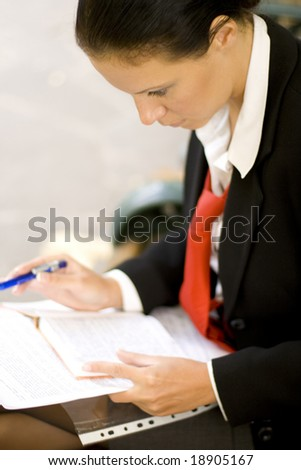 businesswoman is writing notes and planning her schedule - stock photo