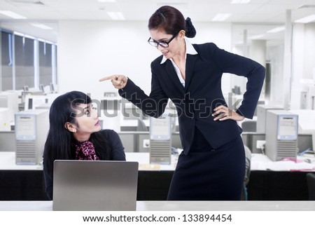 Businesswoman is yelling at her employee - stock photo