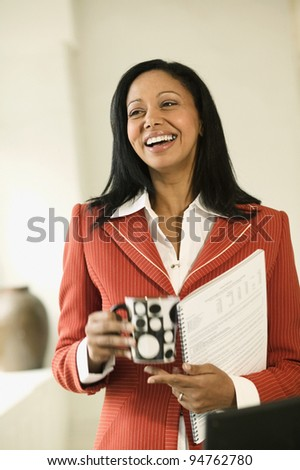Businesswoman laughing - stock photo