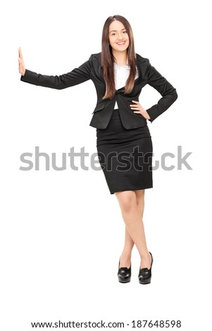 Businesswoman leaning against a wall isolated on white background