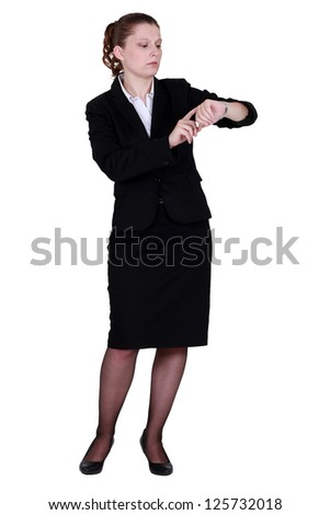 Businesswoman looking at wrist watch - stock photo
