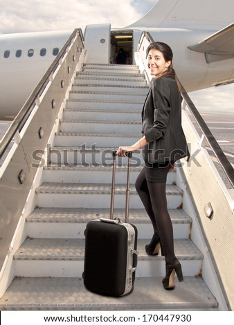 businesswoman looking back before boarding - stock photo