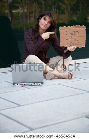 businesswoman looking for a job next to a office building - stock photo