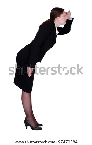 Businesswoman looking for something - stock photo