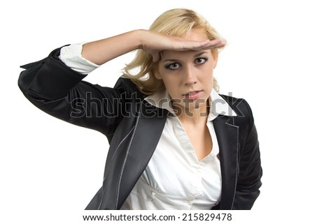 Businesswoman looking into the distance on white background - stock photo