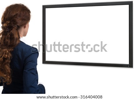 Businesswoman looking on blank monitor screen with copy space. rear view - stock photo