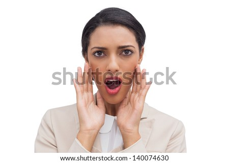 Businesswoman looking shocked on white background