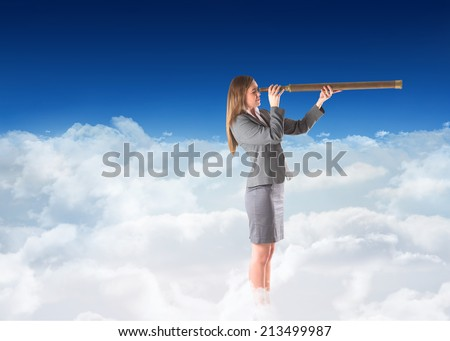 Businesswoman looking through a telescope against blue sky over clouds
