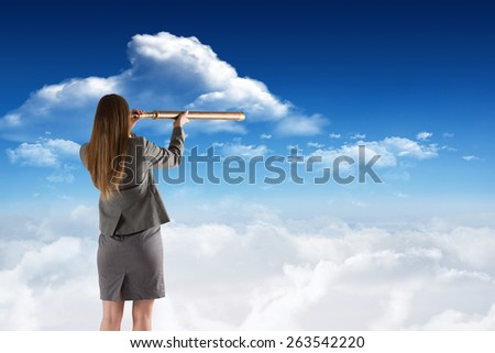Businesswoman looking through a telescope against bright blue sky with clouds