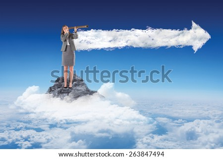Businesswoman looking through a telescope against cloud arrow - stock photo