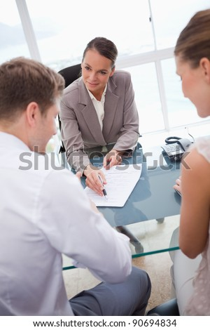 Businesswoman making an offer to negotiation partners - stock photo