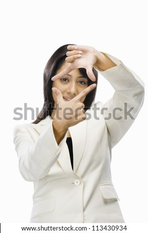 Businesswoman making finger frame - stock photo