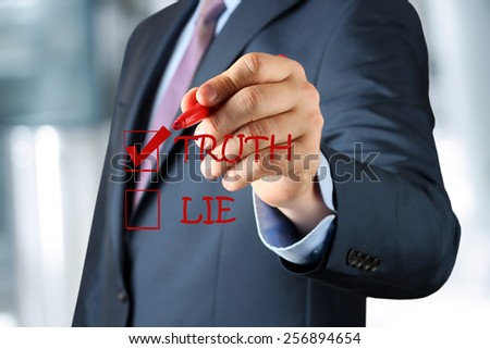 Businesswoman  making  one's choice between truth or lie - stock photo